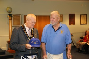 "WB Dale Hobart ""Whitey"" Burgan proudly presenting Charlie's 50 year hat to him. We are sure he will wear it with pride."