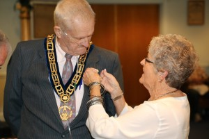 WB Leffler's wife Connie, pinning the Award of Gold to the lapel of his jacket. Indeed, a moment that nearly every Mason hopes to one day achieve- 50 years in the Fraternity!